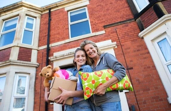 Parent Helping Student Move Into Off Campus Housing Near Rutgers University, New Brunswick